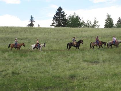 Equestrians enjoy a trail ride at Mueller.