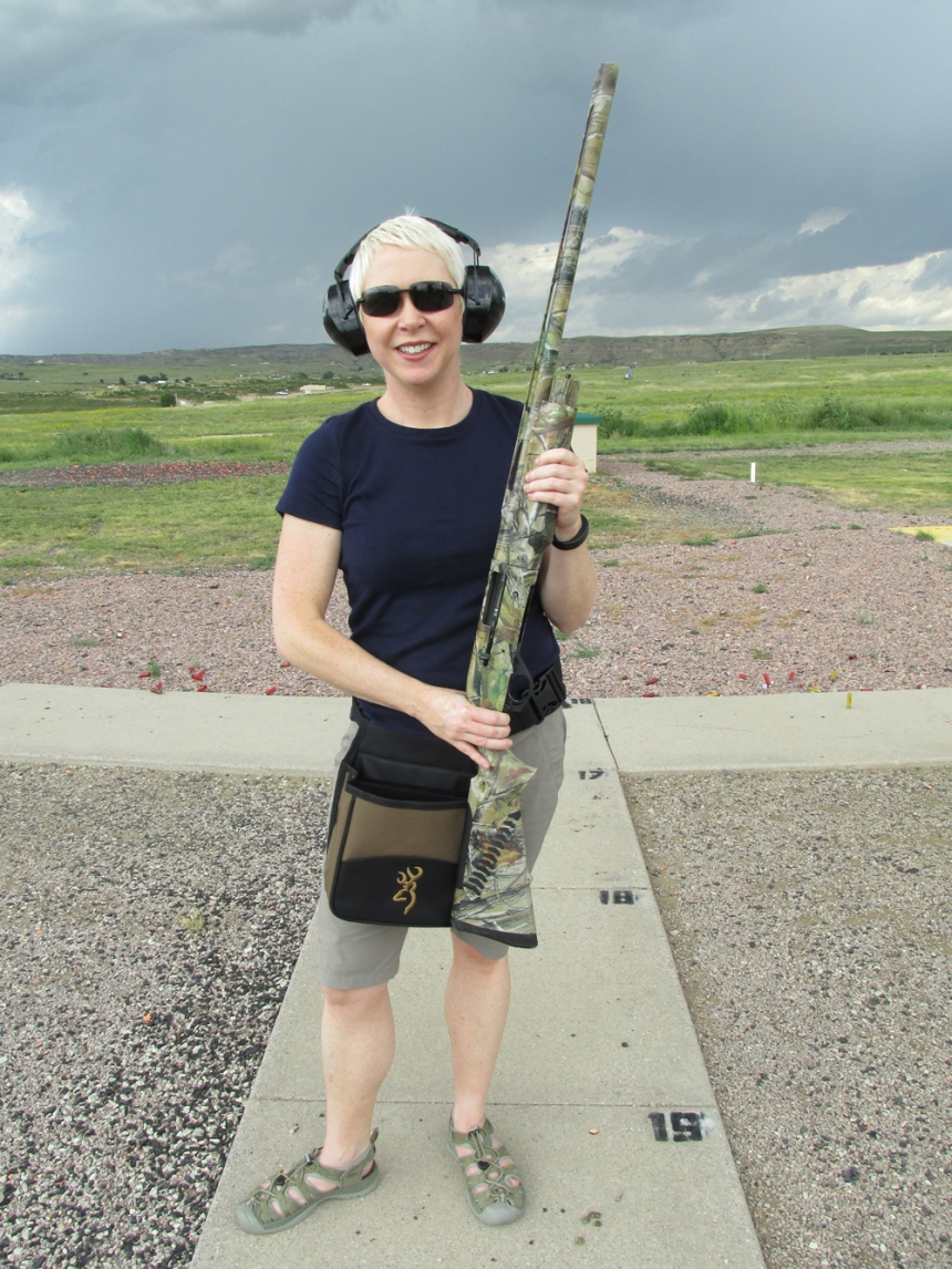 Melinda Miller poses with her shotgun. Photo by David Lien.